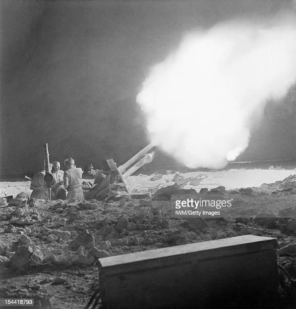 The Battle Of Gazala Libya British 25 pounder guns fire at Erwin Rommel's Afrika Korps on the night of 2 June 1942 during the battle of Gazala Libya...