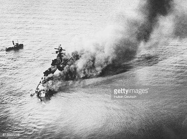 The battleship Admiral 'Graf Spee' breaks up as it burns and sinks to the bottom of the river Plate