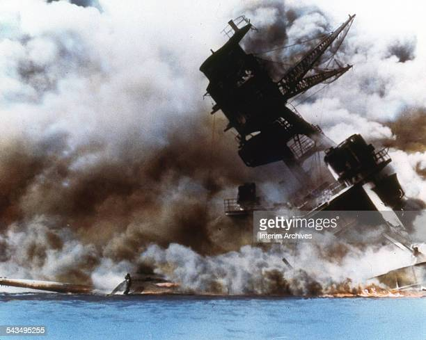 The battleship USS Arizona burns and sinks after the Japanese attack on Pearl Harbor Honolulu Oahu Hawaii December 7 1941