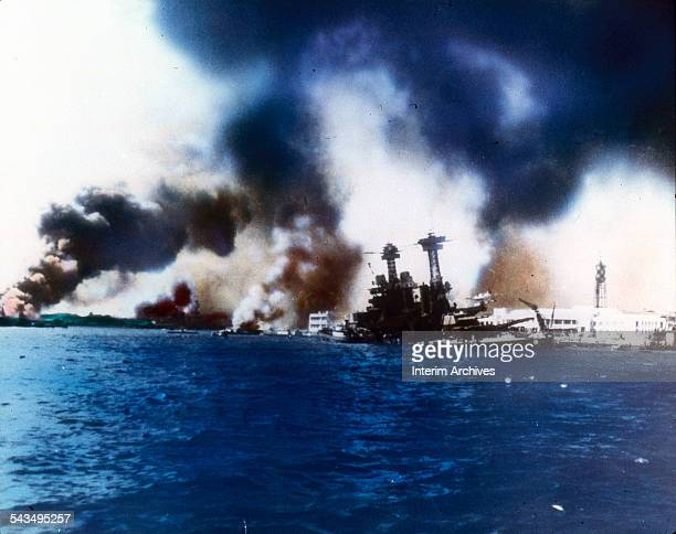 The battleship USS California sinks near Ford Island after the Japanese bombed and torpedoed the ship during the attack on Pearl Harbor Honolulu Oahu...
