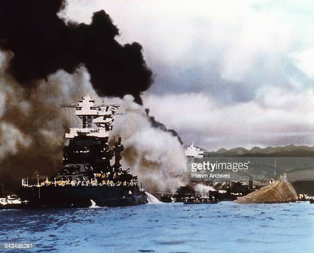 The battleship USS Maryland survived while the USS Oklahoma to which it was connected by a gangway rolled over and capsized during the attack on...