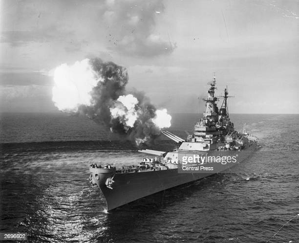The battleship USS Missouri bombards Chongjin, North Korea, with her 16 inch guns during a mission to set out the lines of communication between the...