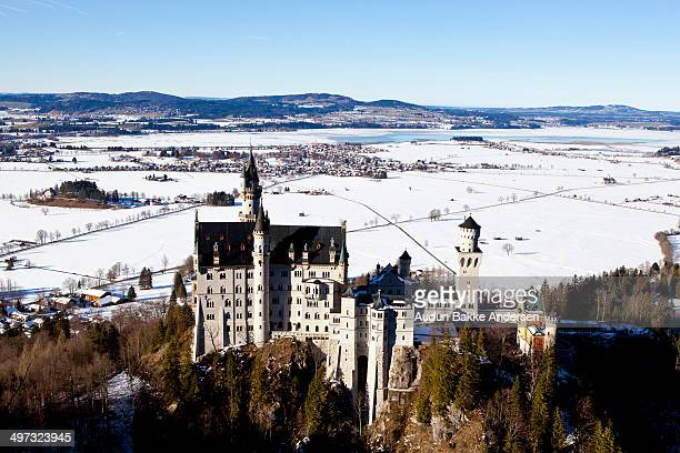 CONTENT] The bavarian castle of Neuschwanstein in Füssen is seen from a nearby hill In the background snow covered fields