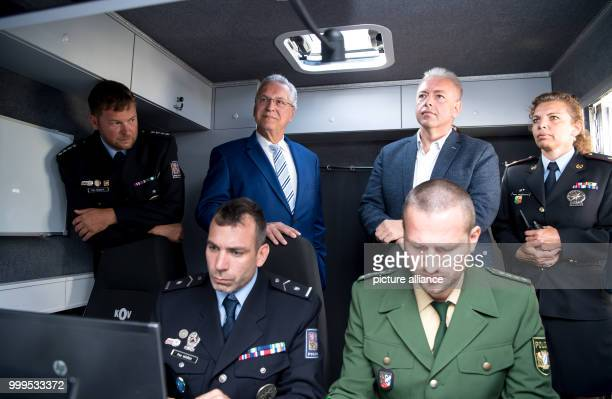 The Bavarian interior minister Joachim Herrmann and his Czech colleague Milan Chovanec can be seen watching the joint crossborder drill involving...
