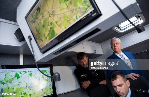 The Bavarian interior minister Joachim Herrmann can be seen watching the joint crossborder drill involving German and Czech police forces in Furth im...