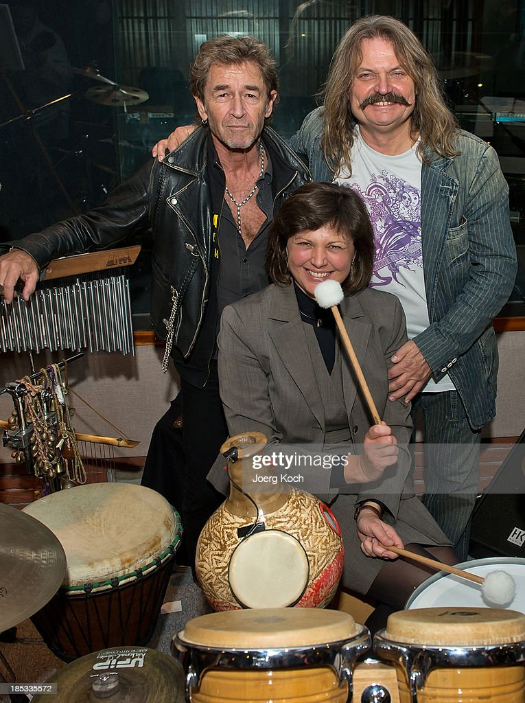 The bavarian minister for economic affairs, Ilse Aigner (CSU), and the musicians Peter Maffay (l) and Leslie Mandoki pose during a get-together for the launch of Mandokis new Album 'BudaBest' on October 18, 2013 in the Red Rock Studios in Tutzing near Munich, Germany. Leslie Mandoki recorded the new album in Budapest featuring Jack Bruce (Cream), Bobby Kimball (Toto), Chris Thompson (former Manfred Mann`s Earth Band), John Helliwell (Supertramp) and Peter Maffay.