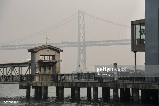 The Bay Bridge is obscured as smoke from the Camp Fire fills the air in San Francisco California US on Thursday Nov 15 2018 The smoke from...