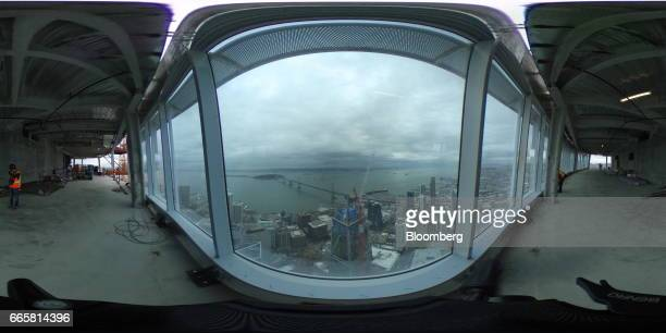 The Bay Bridge is seen during a topping off ceremony for the Salesforce Tower in San Francisco California US on Thursday April 6 2017 The Salesforce...