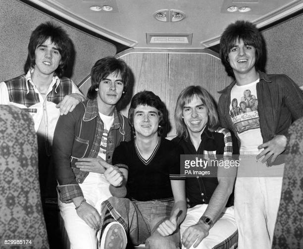 The Bay City Rollers pop group Stuart 'Woody' Wood Alan Longmuir Leslie Mckeown Derek Longmuir and Eric Faulkner on board a jumbo jet at London's...