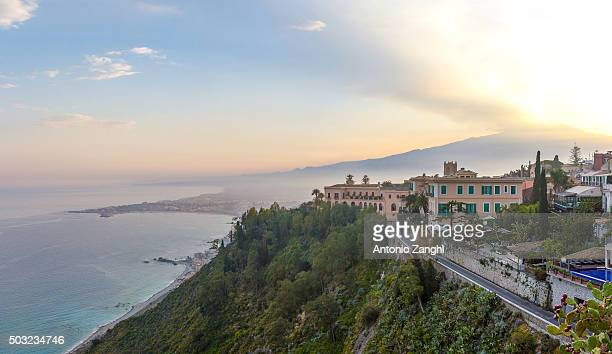 the bay of giardini-naxos with the etna and catania in the background viewed from taormina, sicily italy. - naxos sicily stock pictures, royalty-free photos & images