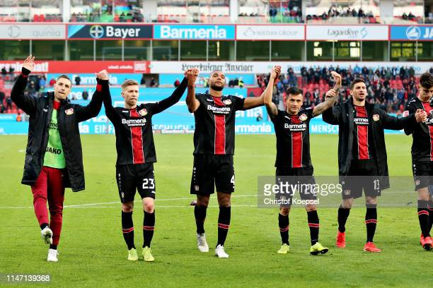 The Bayer 04 Leverkusen team celebrate after winning the Bundesliga match between Bayer 04 Leverkusen and Eintracht Frankfurt at BayArena on May 05...
