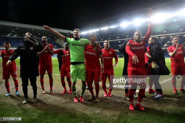 The Bayer 04 Leverkusen team celebrate victory after the UEFA Europa League round of 16 first leg match between Rangers FC and Bayer 04 Leverkusen at...