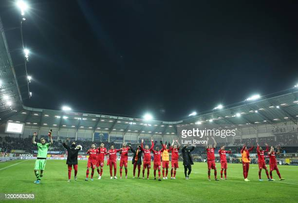 The Bayer Leverkusen side celebrate at the final whistle during the Bundesliga match between SC Paderborn 07 and Bayer 04 Leverkusen at the Benteler...