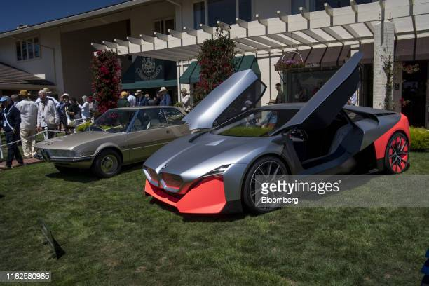 The Bayerische Motoren Werke AG Garmisch concept car, left, and Vision M Next concept car are displayed during the 2019 Pebble Beach Concours...