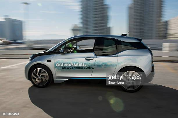 The Bayerische Motoren Werke AG i3 car with ActiveAssist is demonstrated during a press conference during the 2015 Consumer Electronics Show in Las...
