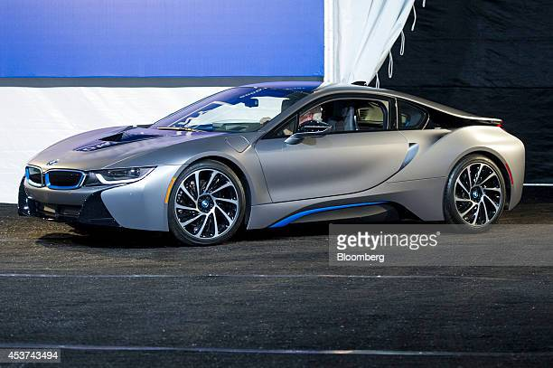The Bayerische Motoren Werke AG i8 is driven into a showroom tent during the 2014 Pebble Beach Concours d'Elegance in Pebble Beach, California, U.S.,...