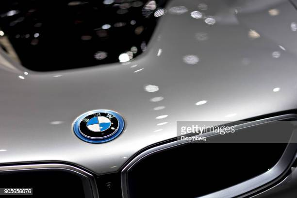 The Bayerische Motoren Werke AG logo is seen on the hood of an i8 plugin coupe vehicle during the 2018 North American International Auto Show in...