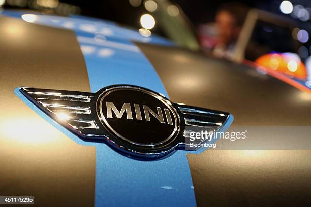 The Bayerische Motoren Werke AG Mini Cooper logo is seen on the hood of a vehicle displayed at the company's booth during the LA Auto Show in Los...