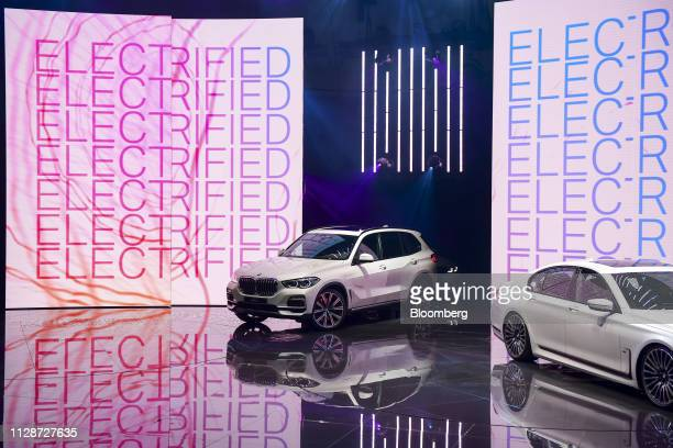 The Bayerische Motoren Werke AG X5 xDrive45e plugin hybrid sports utility vehicle is driven on to a stage on the opening day of the 89th Geneva...