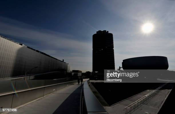 The Bayerischen Motoren Werke AG headquarters are seen in silhouette during the company's news conference in Munich Germany on Wednesday March 17...