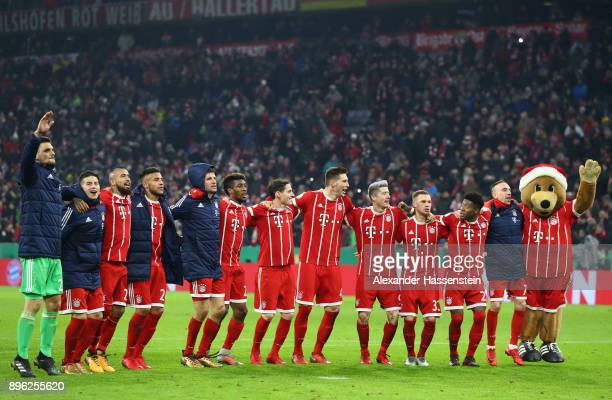 The Bayern Muenchen players show fans appreciation after the DFB Cup match between Bayern Muenchen and Borussia Dortmund at Allianz Arena on December...