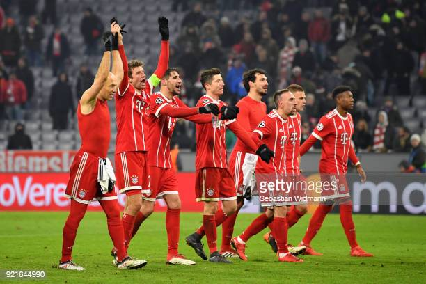 The Bayern Muenchen players show their fans appreciation after the UEFA Champions League Round of 16 First Leg match between Bayern Muenchen and...