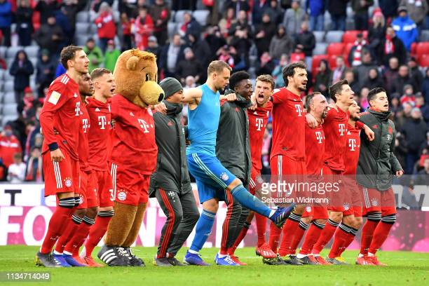 The Bayern Muenchen team celebrate after the Bundesliga match between FC Bayern Muenchen and VfL Wolfsburg at Allianz Arena on March 09 2019 in...