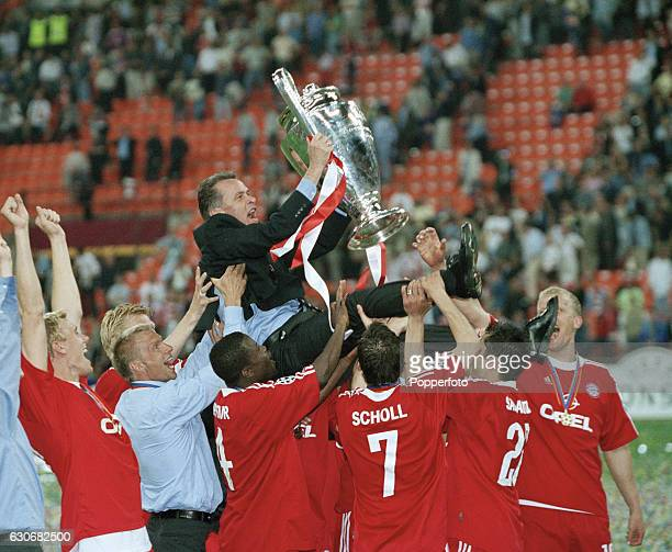 The Bayern Munich fooball coach Ottmar Hitzfeld is chaired with the cup by his team following the UEFA Champions League Final between Bayern Munich...