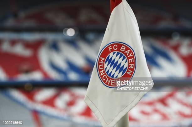The Bayern Munich logo is pictured on the corner flag prior to the German first division Bundesliga football match FC Bayern Munich v TSG 1899...