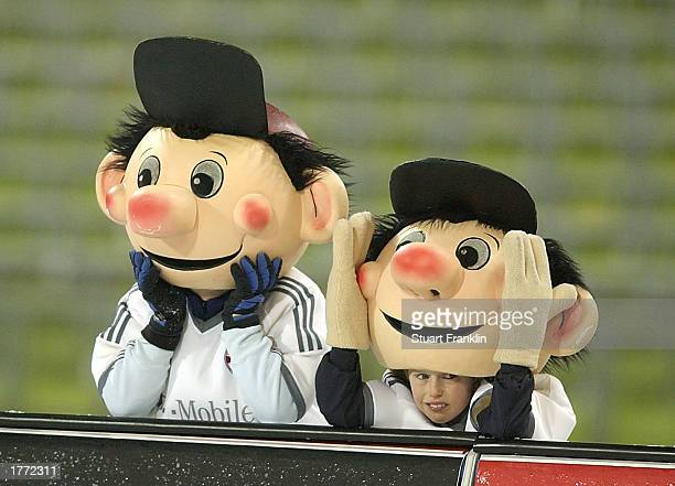 The Bayern Munich mascots look on during the Bundesliga match between Bayern Munich and Hamburg SV played at the Olympiastadion on February 9 2003 in...