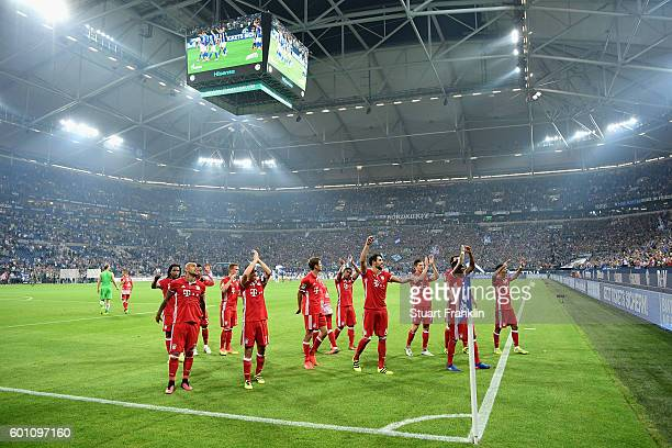 The Bayern Munich players celebrate victory with their supporters following the Bundesliga match between FC Schalke 04 and Bayern Muenchen at...