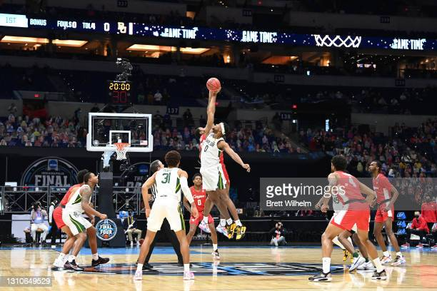 The Baylor Bears and the Houston Cougars tip off to begin their Final Four semifinal game of the 2021 NCAA Men's Basketball Tournament at Lucas Oil...