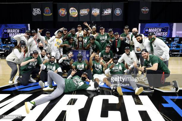 The Baylor Bears celebrate after defeating the Arkansas Razorbacks in the Elite Eight round of the 2021 NCAA Men's Basketball Tournament at Lucas Oil...