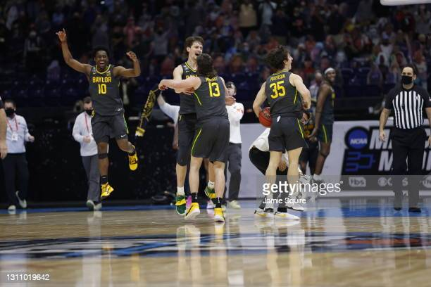 The Baylor Bears celebrate after defeating the Gonzaga Bulldogs in the National Championship game of the 2021 NCAA Men's Basketball Tournament at...