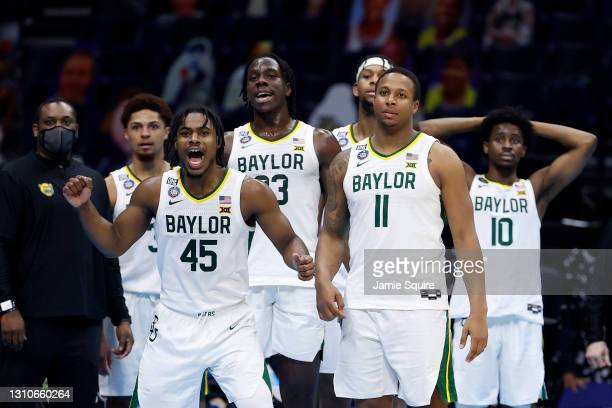 The Baylor Bears celebrate in the final minutes prior to defeating the Houston Cougars 78-59 in the 2021 NCAA Final Four semifinal to advance to the...