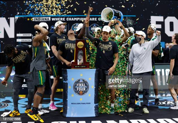 The Baylor Bears celebrate with the trophy after defeating the Gonzaga Bulldogs 86-70 in the National Championship game of the 2021 NCAA Men's...