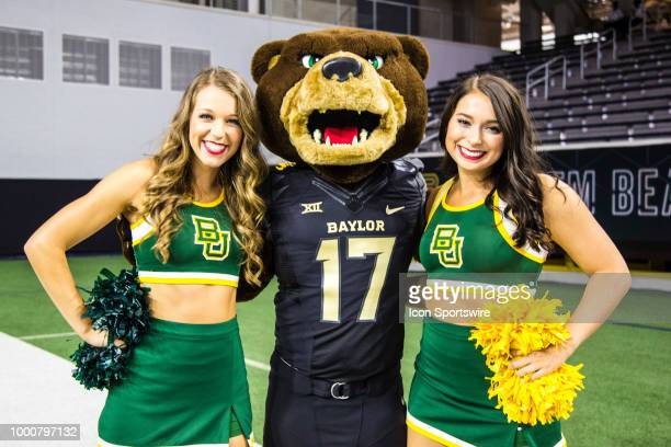 The Baylor Bears cheerleaders and mascot pose for a picture during the Big 12 Media days on July 17 2018 at the Ford Center at The Star in Frisco...