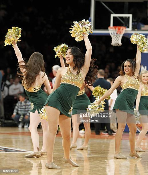 The Baylor Bears cheerleaders in action against the Brigham Young Cougars in the second half during the 2013 NIT Championship Semifinals at the...