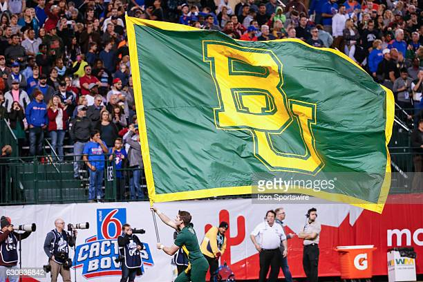 The Baylor Bears flag is brought onto the field before the Motel 6 Cactus Bowl college football game between the Boise State Broncos and the Baylor...