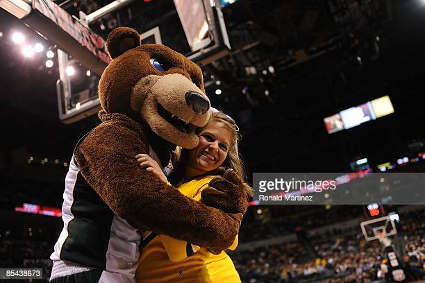 The Baylor Bears mascot hugs a cheerleader during the Phillips 66 Big 12 Men's Basketball Championship finals at the Ford Center March 14 2009 in...