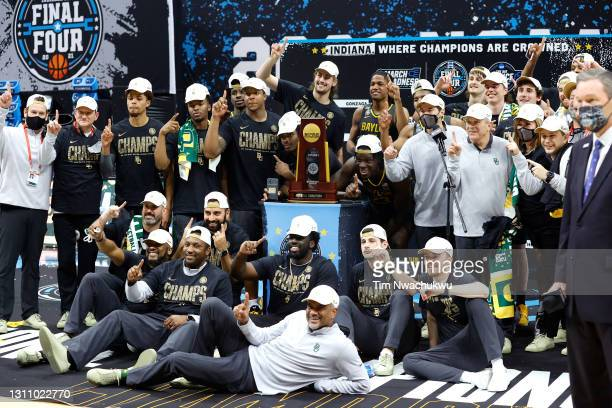 The Baylor Bears pose with the National Championship trophy after winning the National Championship game of the 2021 NCAA Men's Basketball Tournament...