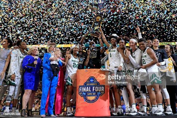 The Baylor Lady Bears celebrate with the NCAA trophy after their teams 82-81 win over the Notre Dame Fighting Irish to win the championship game of...