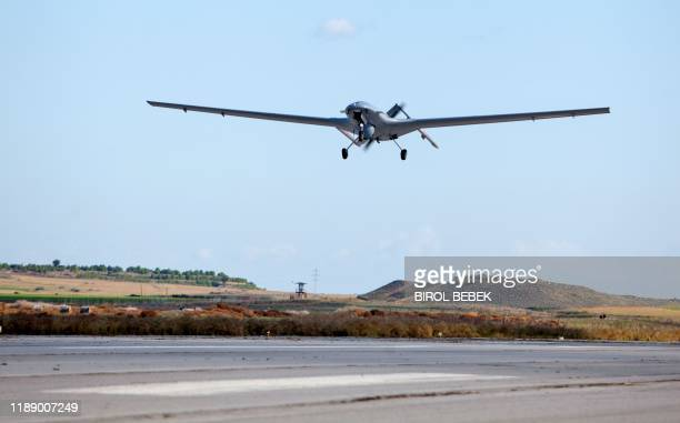 The Bayraktar TB2 drone is pictured flying on December 16, 2019 at Gecitkale military airbase near Famagusta in the self-proclaimed Turkish Republic...