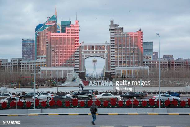 The Bayterek Tower is framed by the archway of the KazMunayGas national Co headquarters in Astana Kazakhstan on Friday April 13 2018 Kazakhstan's...
