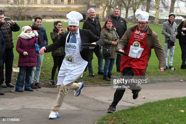 The BBC's Diplomatic correspondent James Landale and Matt Warman MP approach the first corner in the annual Parliamentary Pancake Race in Victoria...