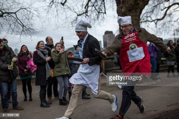The BBC's Diplomatic correspondent James Landale and MP Matt Warman take the first corner in the annual Parliamentary Pancake Race in Victoria Tower...