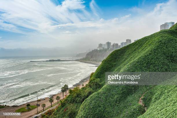 the beach along the cliffs of miraflores neighborhood in lima peru. - peru stock pictures, royalty-free photos & images