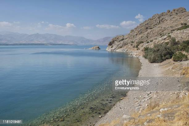 the beach at akdamar island,lake van. - emreturanphoto stock pictures, royalty-free photos & images