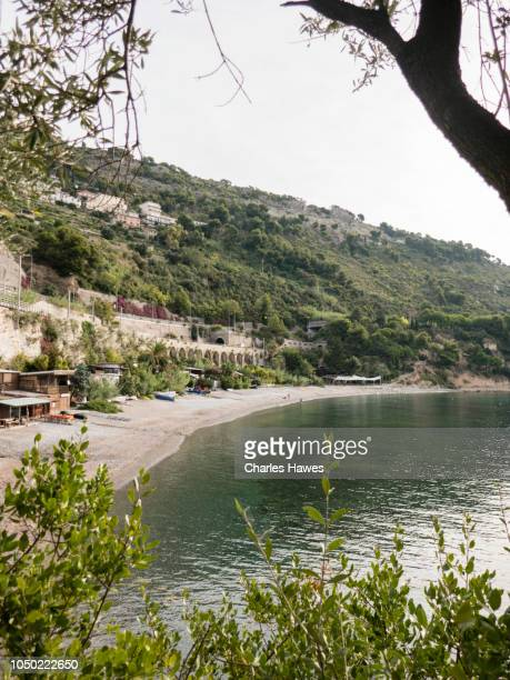 the beach at balzi rossi;image taken from on or near the coast of liguria in northern italy. september - {{asset.href}} imagens e fotografias de stock