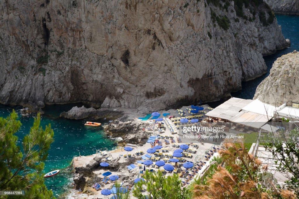 The beach at the Faraglioni's feet : Stock Photo